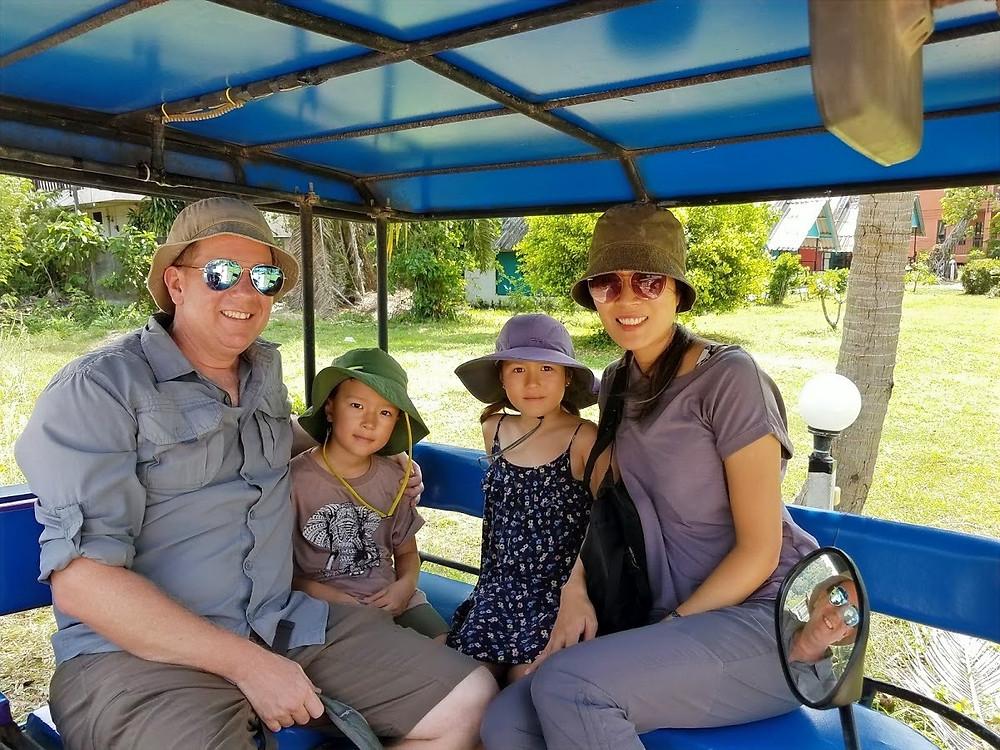 Family inside a tuk tuk in Koh Lanta, Thailand