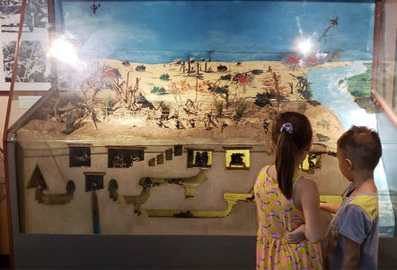 Kids looking at a display in Hanoi's Vietnam Military History Museum.