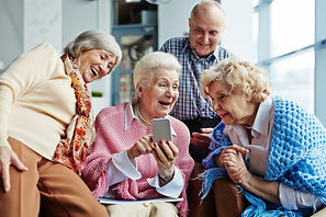 Four cheerful elderly people hanging out
