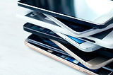 Stack of high-end smartphones on white w