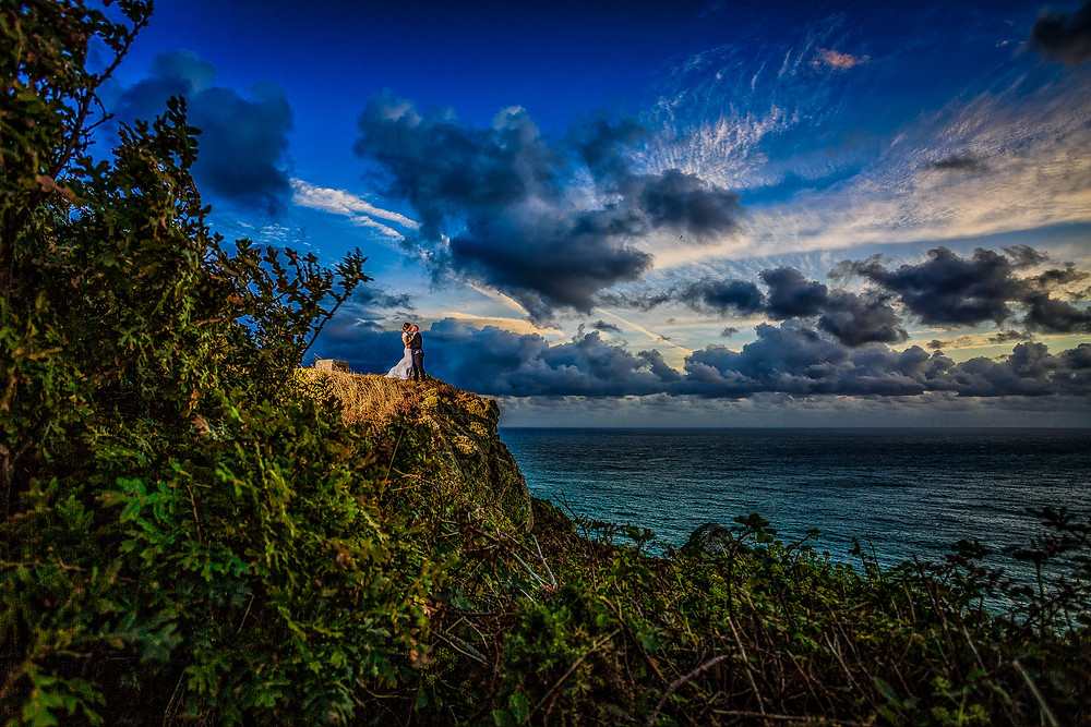Image showing a fully edited image of a couple standing on the cliff