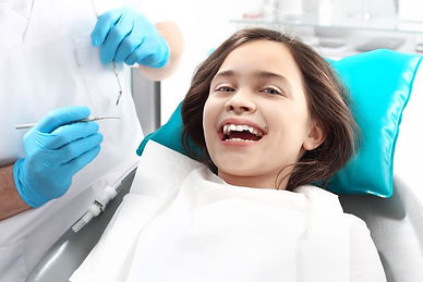 Happy child lauging at the dentist dental office