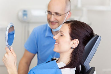 Happy patient and dentist