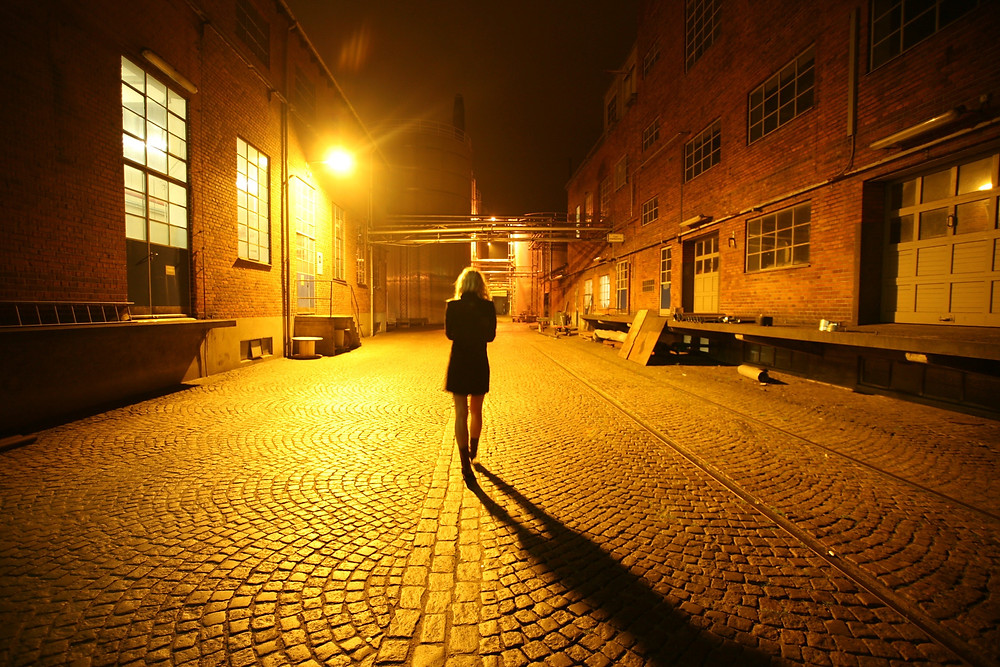 woman walking alone at night