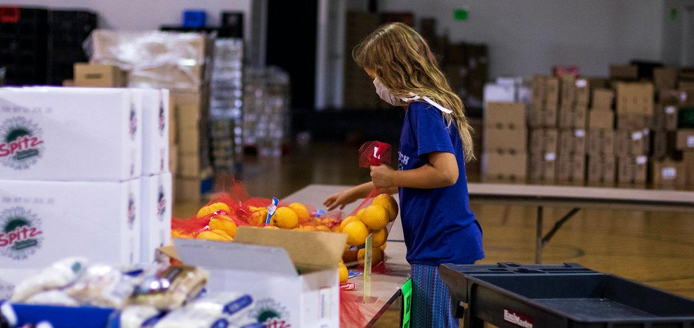 Volunteer girls with oranges Cover.jpg