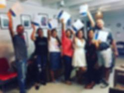 Graduates holding Certificates.jpg