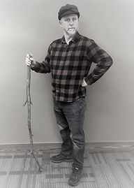 Picture of an older man with plaid shirt, jeans and hunting cap