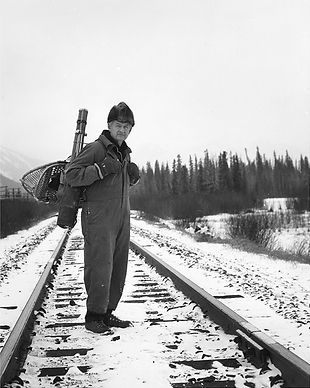 Image: Nicholas Morant with snowshoes and camera gear, ca. 1975 - ca. 1980. Whyte Museum of the Canadian Rockies, Nicholas Morant fonds (V500/I/C1/78/PA-39).