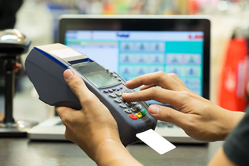 man's hand with credit card swipe throug