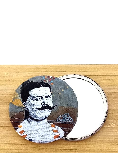 Miroir de poche ou de sac avec visuel d'une oeuvre de l'artiste tourangelle Mam Kaan