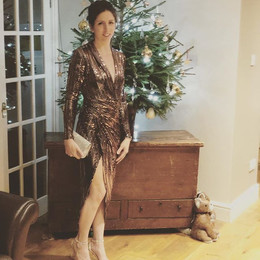 Kerrie Christmas Party ready in a bronze sequined dress in front of her Christmas tree