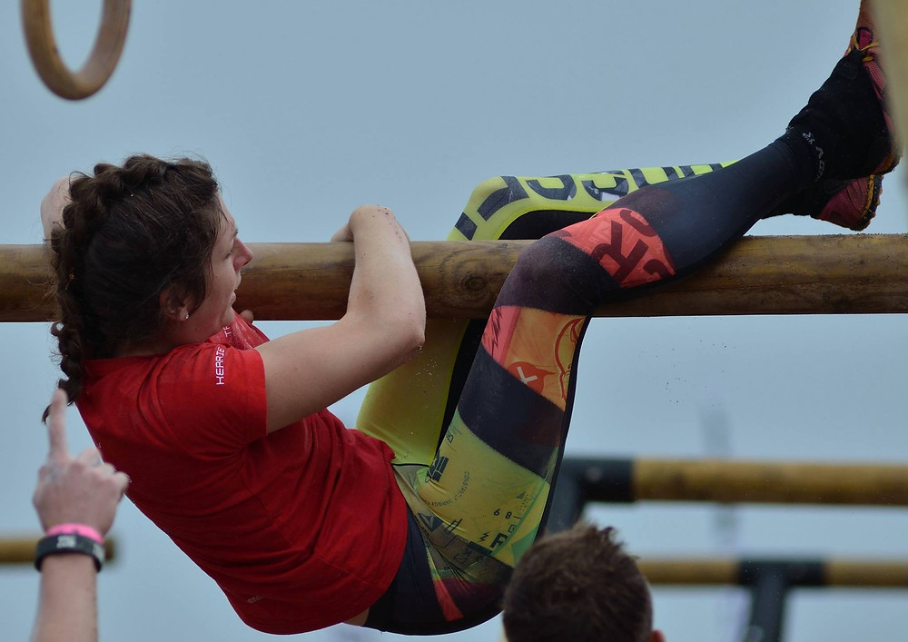 Kerrie Fuller getting up and over a bar unassisted at Tribal Clash, CrossFit competition.