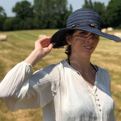 Official shot of Kerrie Fuller wearing a sun hat