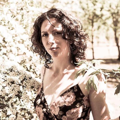 Kerrie Fuller standing amongst trees in summer