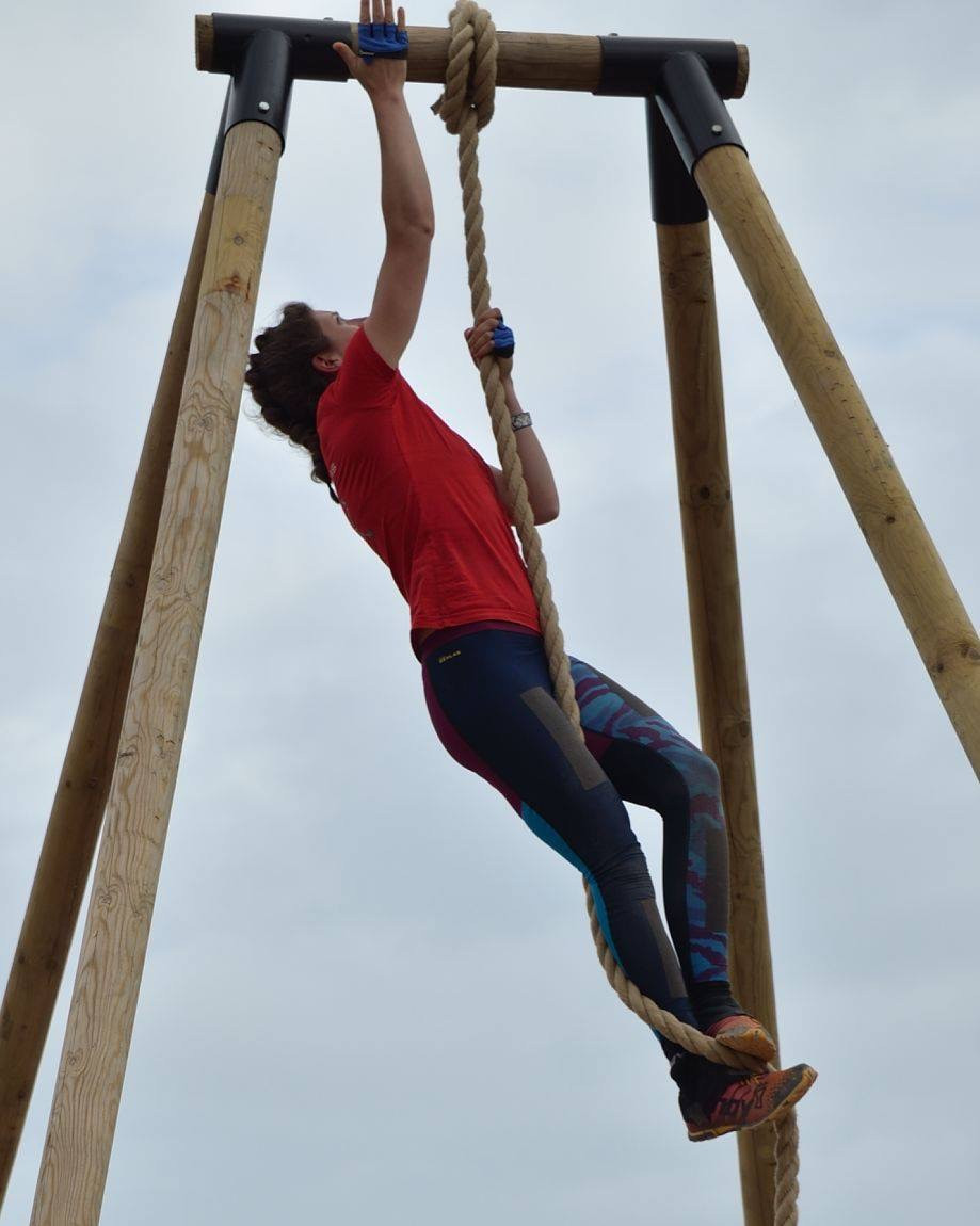 Kerrie Fuller climbing a 15ft rope at Tribal Clash, CrossFit competition.