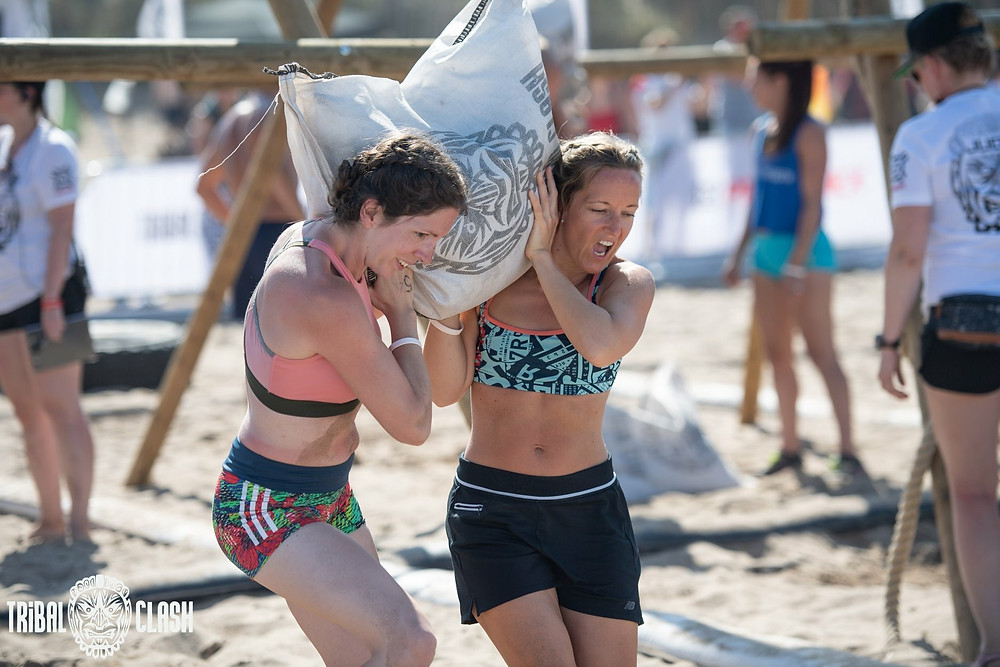 Kerrie Fuller carrying a sandbag at Tribal Clash, CrossFit competition.