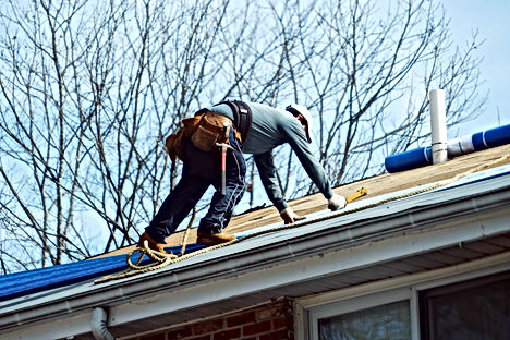 Handyman working on repairing the roof.j
