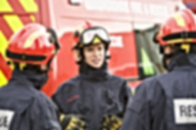 A firefighter giving instructions to her
