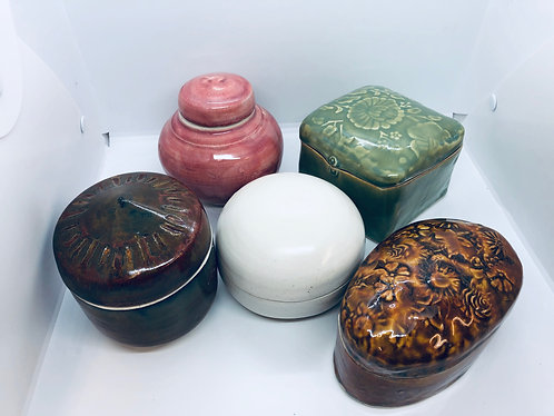 Covered jars, variety of styles and colors