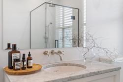 Madelaine floors & Carrara vanity