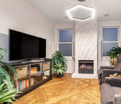 Versailles Timber Panels & Biello Marble Fireplace