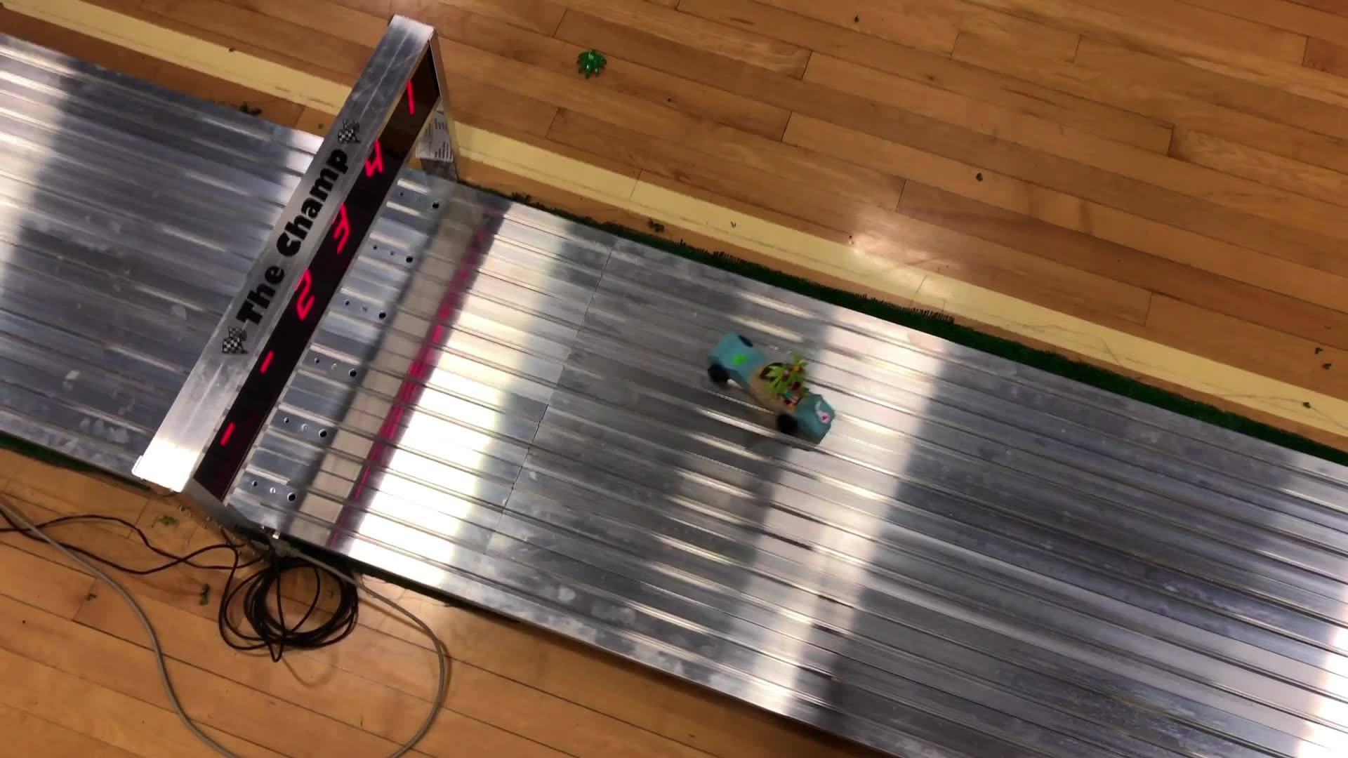 Ruby and Grace entered Thing 1 and Thing 2 into the Dad's & Daughters Pine Car Derby.  There was great debate about which daughter was the proprietor of which car, before, during and after the event.  One placed, the other did not.  Ruby graciously a