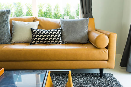 luxury cushion on brown leather sofa in