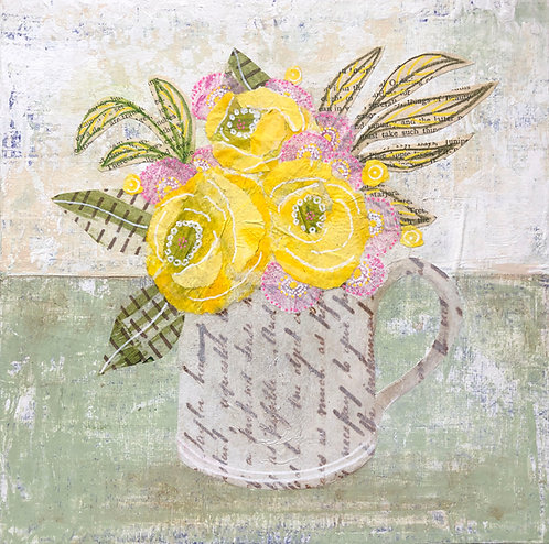 Yellow flowers in an old mug