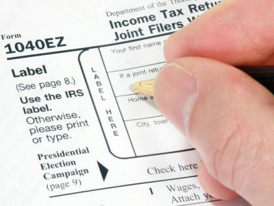 Must a dependent child file a Federal individual tax return if they have taxable income from a W-2 j