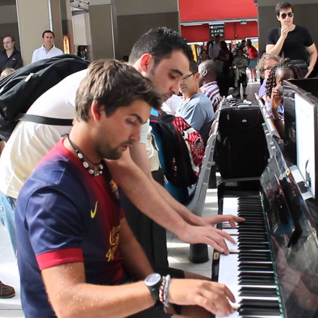 Two perfect strangers playing Piano