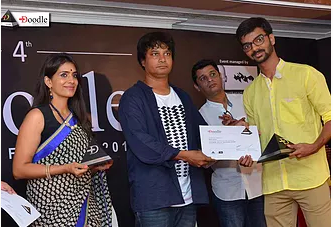 Receiving award at Doodle fest