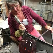 Róisín de Buitlear in the hot workshop