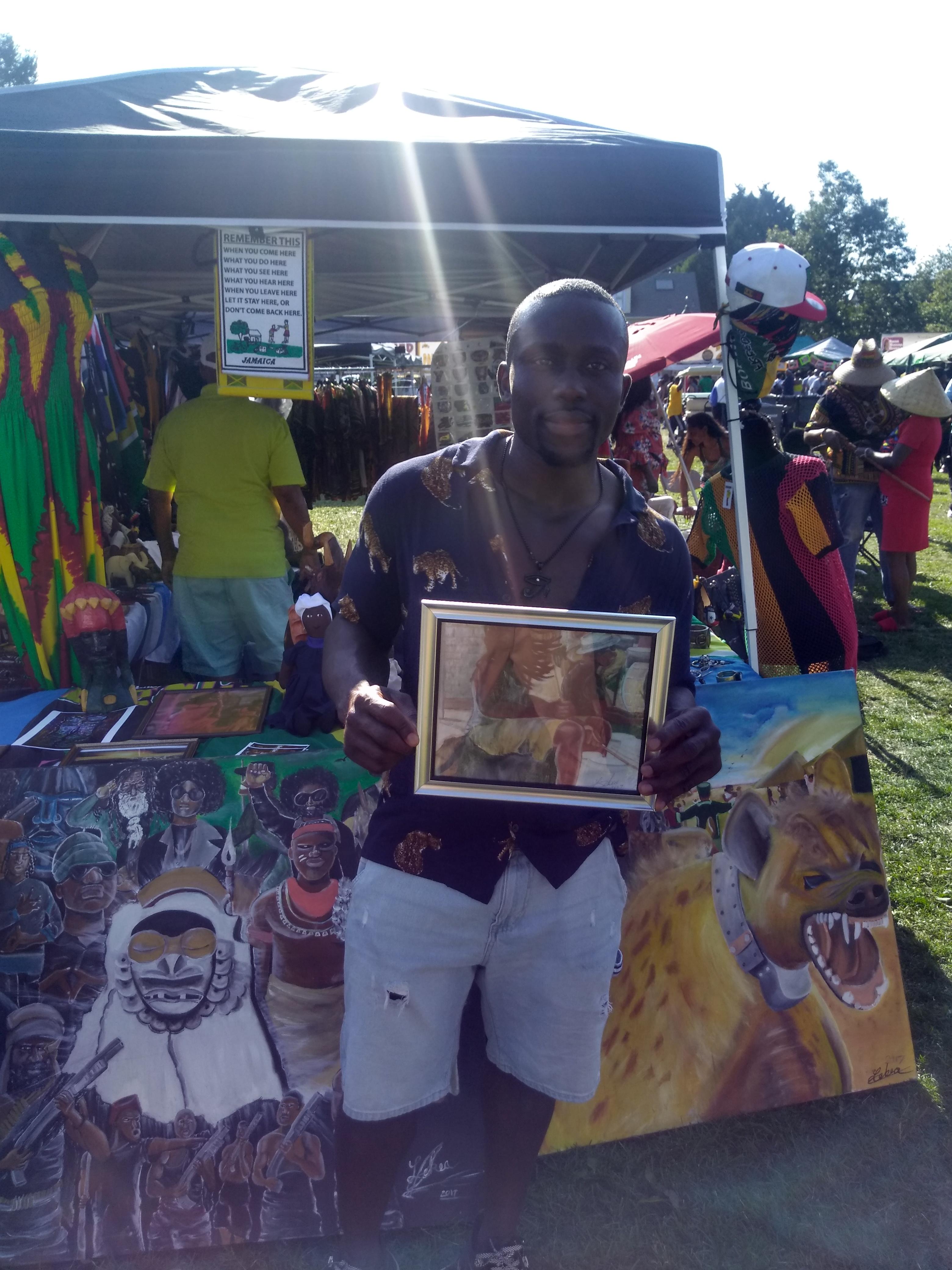 Reuben Gaye Holding up his copy of Drumcity