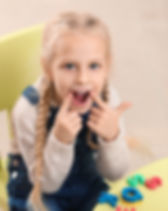 Little girl at speech therapist office.j