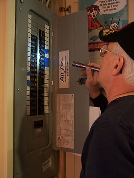 Inspecting the breaker box, DC Home Inspections | Citrus, Marion, & Hernando County