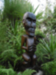 Tiki hawaiien taillé dans du palmier