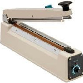 Bag sealer with cutter