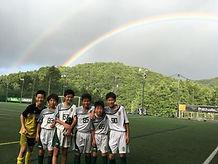 虹と選手.JPG