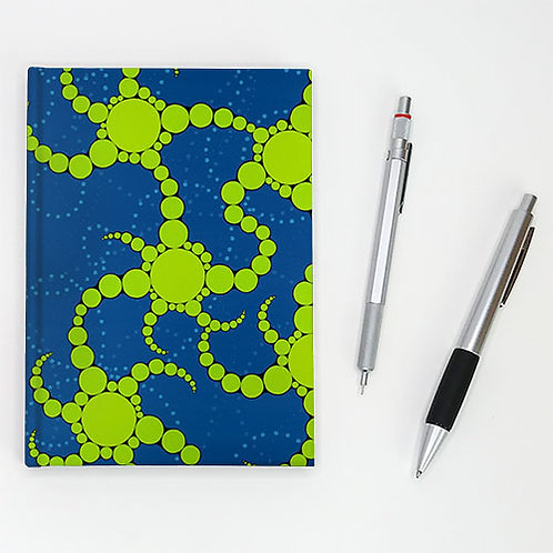 Hardcover journal, pen and pencil, front cover with lime green spirals on blue, by Heidi Hodkinson