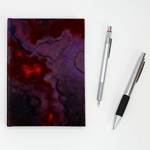 Hardcover journal, pen and pencil, rich purple black front cover with red accent, by Heidi Hodkinson