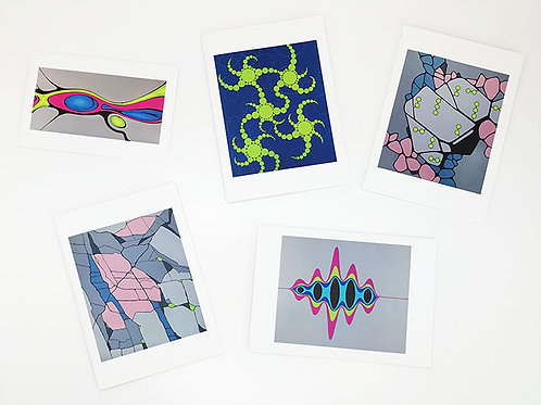 Arrangement of  pink, blue, acid green and grey abstract science art greetings cards by Heidi Hodkinson