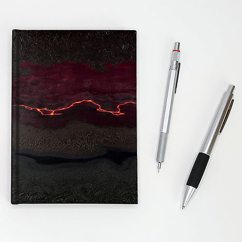 Hardcover journal, pen and pencil, front cover print of black with orange fissure, by Heidi Hodkinson