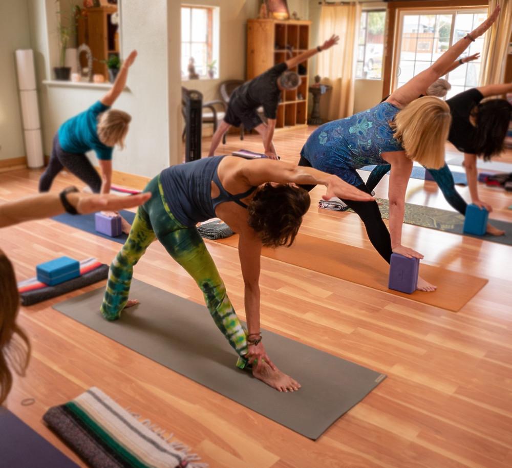 Mary Monahan and Lori Pirri demonstrate 'Triangle Pose'