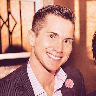 Waymon Hudson smiling in black and white photo