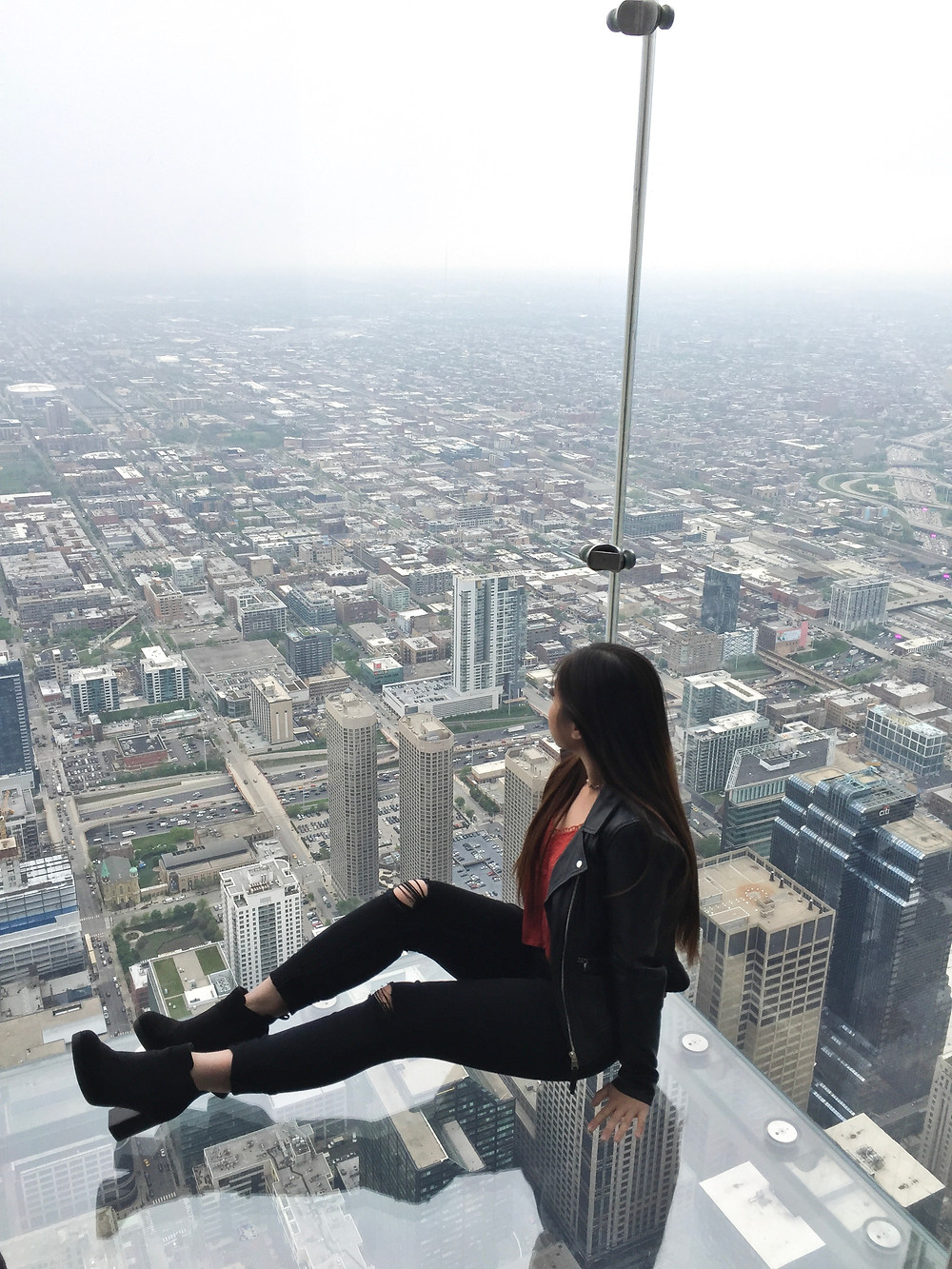 Skydeck at Willis Tower in Downtown Chicago sitting on glass platform