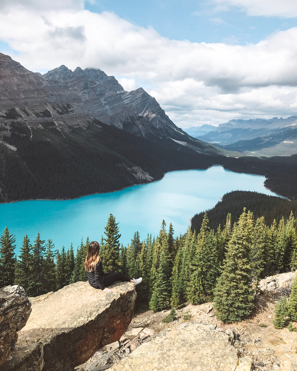 peyto lake secret rock turquoise blue lake forest alberta canada