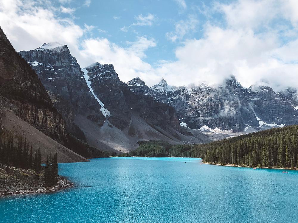 moraine lake rock pile turquoise lake water