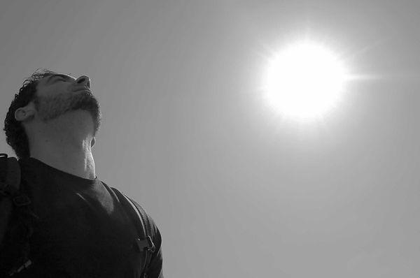man-silhouette-light-black-and-white-sky