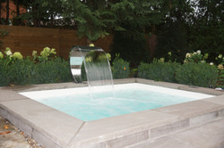 Hot tub with water fixture