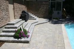Interlocking pavers on concrete base